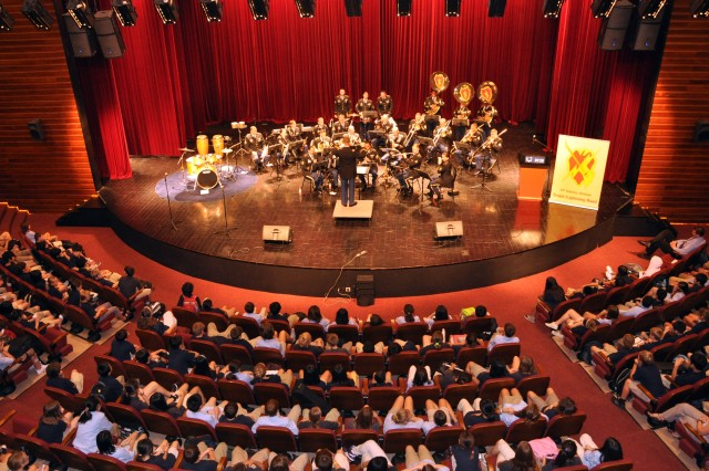 The 25th Infantry Division band takes the stage at the Shanghai Community International School performing for a packed house full of international elementary and high school students. The division band is in China on an international community relations mission representing the U.S. Army and Pacific Command. This performance was the first of this mission and is followed by multiple performances at the World Expo 2010 in Shanghai, China.