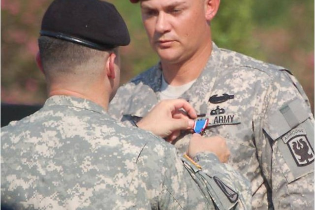 Col. Michael Fenzel, commander of the 2nd Brigade Combat Team, 1st Armored Division, at Fort Bliss, Texas, pins the Distinguished Service Cross on Sgt. 1st Class Jack White, an Airborne School instructor with 1st Battalion (Airborne), 507th Parachute Infantry Regiment, Sept. 7 at the 173rd Airborne Memorial.  White received the Distinguished Service Cross for his actions in Khost Province, Afghanistan, June 29, 2008.