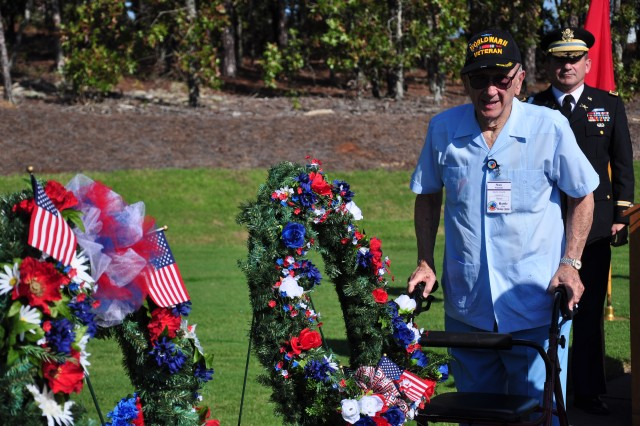 Stan Wapinski, of Columbia, participates in a wreath laying ceremony Saturday at the Fort Jackson National Cemetery. Wapinski served with the 26th Infantry Division during the Battle of the Bulge.
