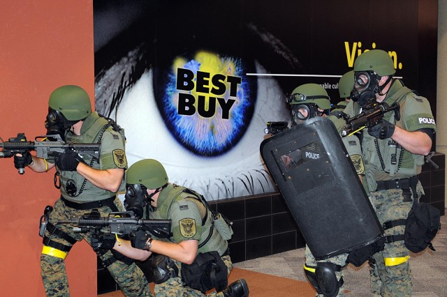 Minneapolis - The Richman special weapons and tactical unit clears out notional hostiles, who unleashed a biological weapon during a simulated attack at the Best Buy Corporate Headquarters building here Aug. 25. Members of Army North's Civil Support Training Activity team, out of San Antonio, Texas, deployed to Minneapolis during the pre-evaluation training exercise in support of the 55th Civil Support Team, which was called upon by the local Richfield County police and fire department to help decontaminate a crime scene. The 55th CST is a Minnesota Army National Guard unit based out of Fort Snelling, Minn.