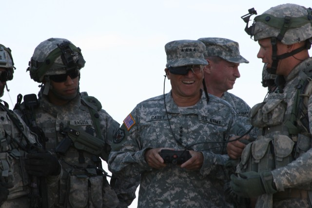 Soldiers from 5th Brigade, 1st Armored Division, Army Evaluation Task Force, watch as Gen. George W. Casey Jr., Army chief of staff, operates the remote control to the small unmanned ground vehicle at White Sands Missile Range, N.M.
