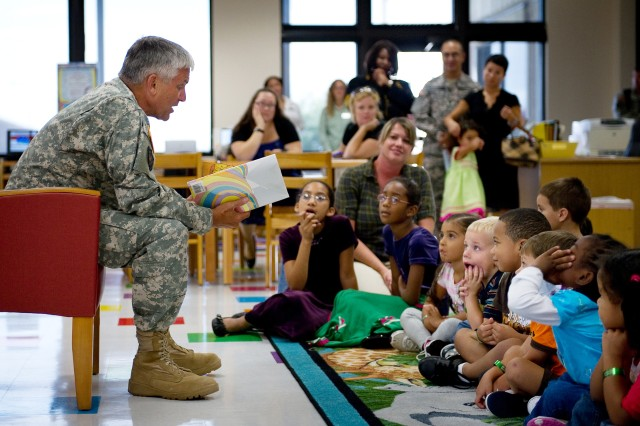 Children listen while the Chief of Staff of the Army, Gen. George W. Casey Jr. reads a Dr. Seuss book in the newly constructed children's portion of the Casey Memorial Library at Fort Hood, Texas, Sept. 8, 2010.