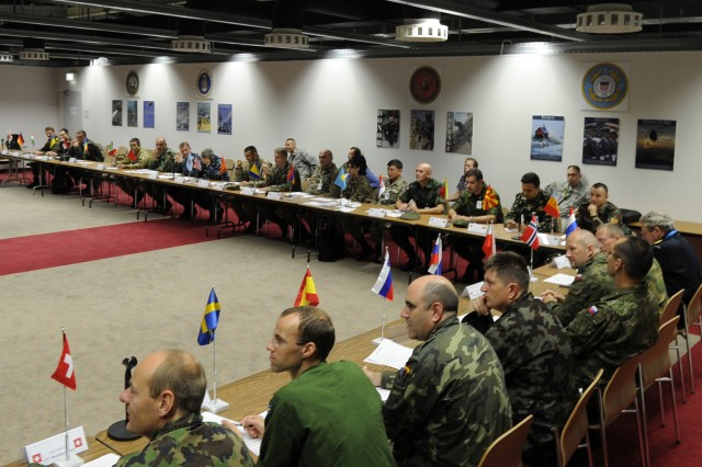 Delegation chiefs gather for a video conference with their counterparts in Romania during exercise Combined Endeavor 2010 at the Grafenwoehr (Germany) Training Area, Sept. 2. The exercise, called the world's largest military communications and information systems exercise, brought together personnel from more than 40 nations and organizations.