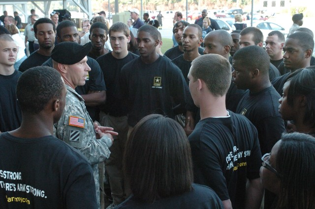Third Infantry Division-Rear Command Sergeant Major Jeffrey Ashmen talks to Jacksonville Recruiting Battalion's new recruits about quality of life in the military and their expectations, prior to the start of the battle of the nationally-ranked football teams, as Camden County High School  took on Central Miami (Fla.), Sept 4.