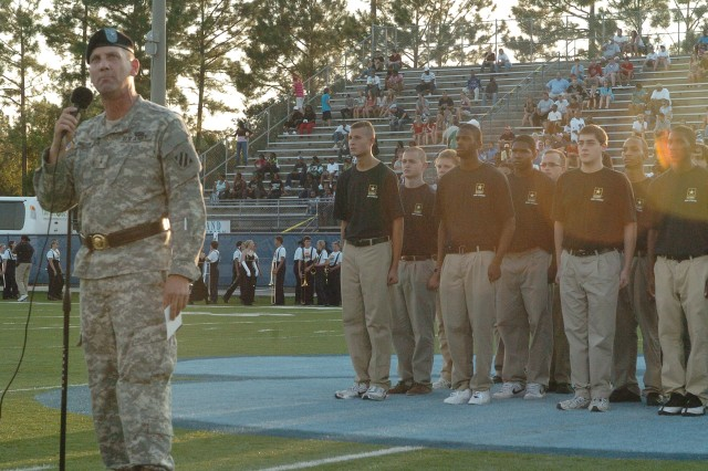 Third Infantry Division Deputy Commanding General-Rear, Brig. Gen. Jeffrey Phillips stands with approximately 40 Jacksonville (Fla.) Recruiting Battalion Recruits at Camden High School, prior to administering the oath of enlistment, Sept. 4.