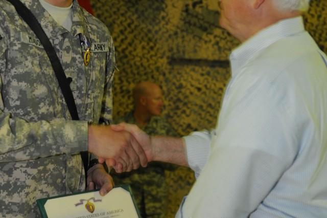 Vanguard Soldier receives Purple Heart from U.S. Defense Secretary