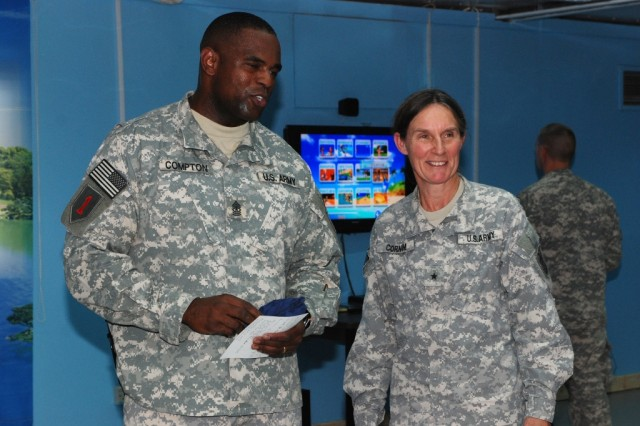 Sgt. Maj. Teddy Compton, the 1st Infantry Division personnel sergeant major, shows Brig. Gen. Rhonda Cornum, director of Comprehensive Soldier Fitness, through the physical wing of the Basra Resiliency Center Sept. 9. The center uses unique methods to help Soldiers become more physically and mentally fit.