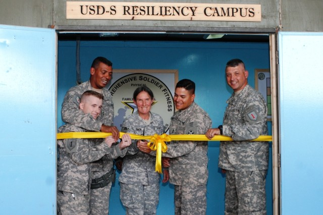 From Left, Sgt. Matthew Richards, of the 329th Forward Support Company, 3rd Advise and Assist Brigade, 4th Infantry Division, Maj. Gen. Vincent Brooks, the United States Division - South commanding general, Brig. Gen. Rhonda Cornum, the director of Comprehensive Soldier Fitness, Sgt. 1st Class James Padilla of the 4th Squadron, 10th Cavalry Regiment, and Command Sgt. Maj. Jim Champagne, the USD-S senior noncommissioned officer., cut the ribbon to the entrance of the USD-S Resiliency Campus Sept. 9.