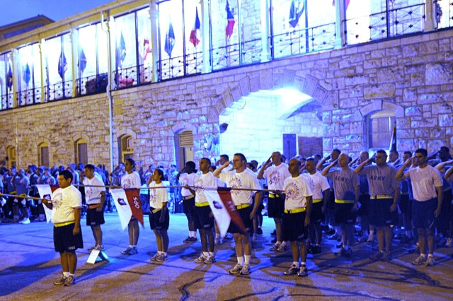 FORT SAM HOUSTON, Texas - Servicemen and women from U.S. Army North and Fort Sam Houston honor the colors before heading out in the pre-dawn hours Sept. 10 at the historic Quadrangle during Fort Sam Houston's inaugural Freedom Walk. Several hundred Fort Sam Houston service members and community members turned out for the Freedom Walk 2010 event to honor the victims of the 9/11 attacks and to support American service members. The event was hosted by Army North, the Army Service Component Command and Joint Forces Land Component Command to U.S. Northern Command. It conducts homeland defense, civil support operations and theater security cooperation activities in order to protect the American people and our way of life.