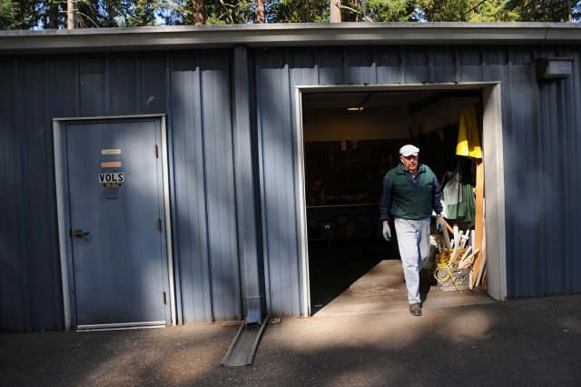 "Chuck Aly walks out of the volunteer tool shed at Eagles Pride Golf Course, Aug. 30 after finishing a day's worth of work. ""We love the golf course, and we think we're doing some good for it, so why not come back'"" Aly says."