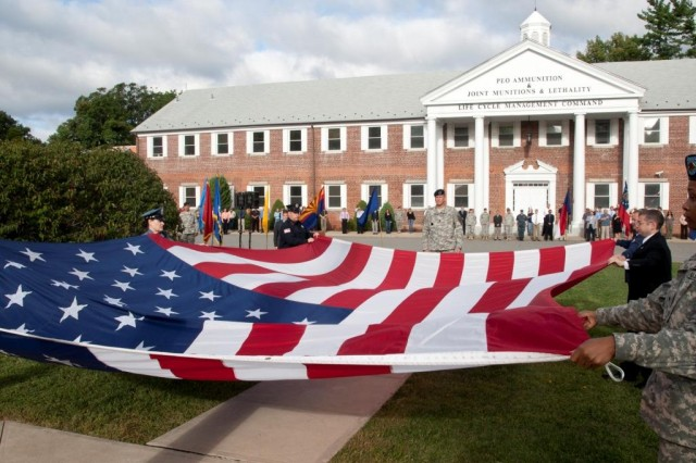 Military and civilian personnel, along with Picatinny police, fire and medical department representatives fold the American flag during a 9/11 remembrance ceremony at Picatinny Arsenal, Sept. 10, 2010.