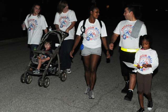 FORT SAM HOUSTON, Texas - Several hundred service members, wounded warriors, Civilians and community members walk a mile-long circuit in the pre-dawn hours around the historic Quadrangle Sept. 10 to honor the 2,993 victims killed in the 9/11 attacks, and to support American service members, during the Freedom Walk 2010 event hosted by U.S. Army North.