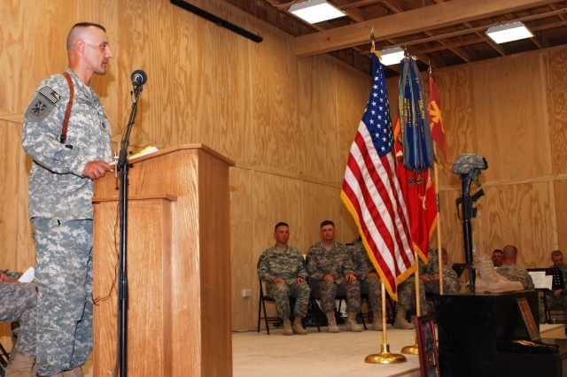 Capt. Lloyd Sporluck, the commander of Battery A, 5th Battalion, 5th Air Defense Artillery Regiment, speaks to the assembled Soldiers and leaders at the memorial ceremony for Sgt. Brandon Maggart at the Contingency Operating Base Basra chapel Aug. 24.