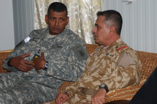 Maj. Gen. Vincent Brooks, commanding general of the 1st Infantry Division and United States Division-South, speaks with Iraqi Army Staff Maj. Gen. Aziz Noor Swady, commander of the 14th IA Division, during an Iftar celebration on Contingency Operating Base Basra Aug. 28. The Iftar dinner is when Muslims break their fast during the holy month of Ramadan.