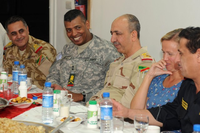 Maj. Gen. Vincent Brooks, United States Division- South commanding general, Staff Maj. Gen. Abdul Aziz Noor Swady (far left), 14th Iraqi Army Division commander, Staff Lt. Gen. Muhammad Jawad Huwaidi (center), Basra Operations Center commander, and Gen. Adel Daham Fahad Al Amery (far right), Basra Provincial Chief of Police, share a laugh with Alice Walpole, the British Consulate General, during an Iftar gathering on Sept. 6 at the British Embassy Compound on Contingency Operating Base Basra.