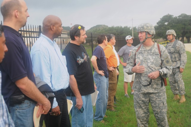 """CAMP BULLIS, Tx - Brig. Gen. Les J. Carroll, 4th Sustainment Command (Expeditionary) commanding general and Command Sgt. Major  Gerald Capps, 4th ESC command sergeant major, greet the employers after their Black Hawk helicopter ride during the Employer Support of the Guard and Reserve """"Boss Lift"""" event here Sept. 11. Employers were given the chance to see what their Reserve Component employees do when they are away from their civilian occupation for Military duty."""
