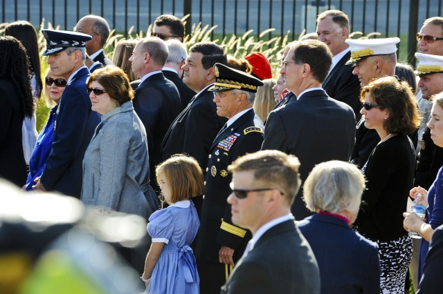 Senior Defense Department officials mingle with the families of the fallen as they listen to the remarks of President Barack Obama during a memorial ceremony at the Pentagon Memorial, Sept. 11, 2010. The ceremony marked the ninth anniversary of the terrorist attack that killed 184 people near this spot in 2001.