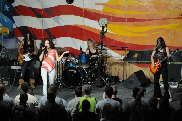 """Hammer of the Broads performed for servicemembers at Contingency Operating Base Speicher, Iraq, Sept. 8. Hammer of the Broads is an all-female tribute band to Led Zeppelin, playing songs such as """"Stairway to Heaven"""" and """"Heartbreaker."""""""