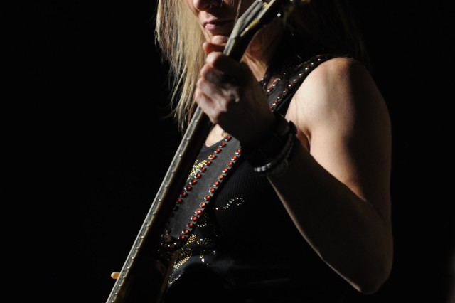 Tina Wood, guitarist for Hammer of the Broads, performs at Contingency Operating Base Speicher, Iraq, Sept. 8. Although the group performed in Iraq earlier in the year, this is the first tour for the band as Hammer of the Broads.