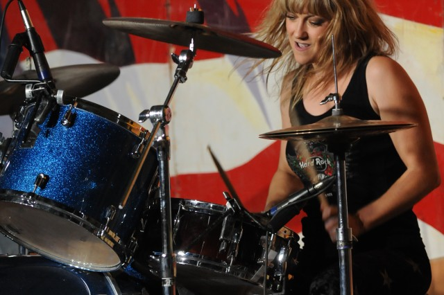 Nikki Lane Taylor, the drummer with Hammer of the Broads, performs at Contingency Operating Base Speicher, Iraq, Sept. 8. The band is on tour in Iraq to help raise the morale of the troops.