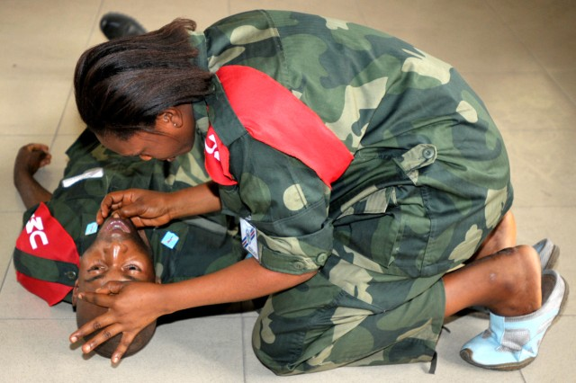 Soldiers from the Armed Forces of the Democratic Republic of Congo's Immediate Response Unit (FARDC UMIR) demonstrate opening a patients airway, during classroom training in Kinshasa, DRC, Sept. 7. Members are participating in MEDFLAG 10, a joint military training exercise between the U.S. military and FARDC soldiers to enhance emergency response capabilities in the region.