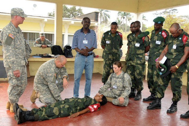 Members of the 814th Army Support Medical Company based in Bismarck, N.D., instruct Soldiers from the FARDC Immediate Response Unit (UMIR) on patient assesment in Kinshasa, Democratic Republic of Congo. The units are participating in MEDFLAG 10 a joint military training exercise between the U.S. military and FARDC to enhance emergency response capabilities in the region.