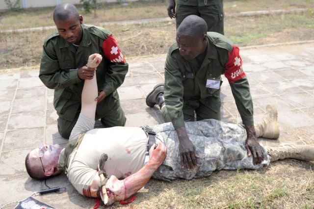 Sgt. Kyle Rittenbach of Bismarck, N.D., portrays a casualty during training with the Armed Forces of the Democratic Republic of Congo, Sept. 9 in Kinshasa, DRC. Rittenbach, a member of the 814th Army Support Medical Company based in Bismarck, N.D., is participating in MEDFLAG 10 a joint training exercise between U.S. military and FARDC soldiers to enhance emergency response capabilities in the region.