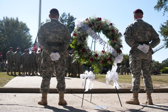 Staff Sgt. Loren Gernandt, left, XVIII Airborne Corps Noncommissioned Officer of the Year, and Staff Sgt. Lance Noell, 82nd Airborne Division NCO of the Year, stand beside the wreath while the 82nd Airborne Division Chorus performs during the Sept. 11 Remembrance Ceremony at the Fort Bragg Main Post Parade Field Friday. The ceremony rendered honors to not only those who perished in the attacks, but also to the heroes who saved lives that day and the servicemembers who are still fighting the war against terrorism.