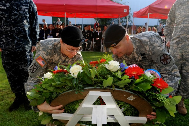 U.S. Army Garrison Brussels commander Lt. Col. Francesca Ziemba (left) and Command Sgt. Maj. Robert G. Lehtonen II lay a wreath to honor those lost during the attacks on America on Sept. 11, 2001.