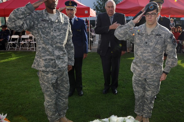 Sgt. Lorenzo B.Meekins (left) and Spc Justin R. Miller (right) render honors after laying a wreath during the U.S. Army Garrison Brussels Sept. 11 commemoration ceremony.