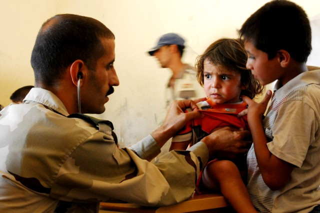 An Iraqi Army doctor examines an child Sept. 7 during an Iraqi Security Forces-led combined medical engagement and humanitarian aid mission. U.S. forces partnered with the ISF to host the event.