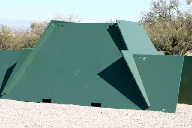 "This photo shows one of the new ""greener"" targets installed on ranges 9 and 12 as part of the fort's ongoing projects to enhance the environment. This silhouette resembles a Russian BMP, armored personnel carrier, and is made completely out of recycled steel."