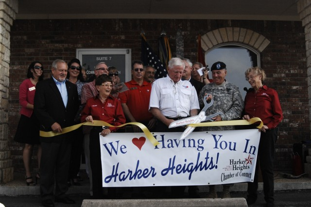 Harker Heights Mayor Ed Mullen (center, white shirt), Maj. Gen. Will Grimsley, Fort Hood's senior acting commander and members of the Harker Heights Chamber of Commerce cut the ribbon to open the Fort Hood Community Outreach Center Sept. 9 in Harker Heights, Texas. The campus is the first of its kind in the Army.