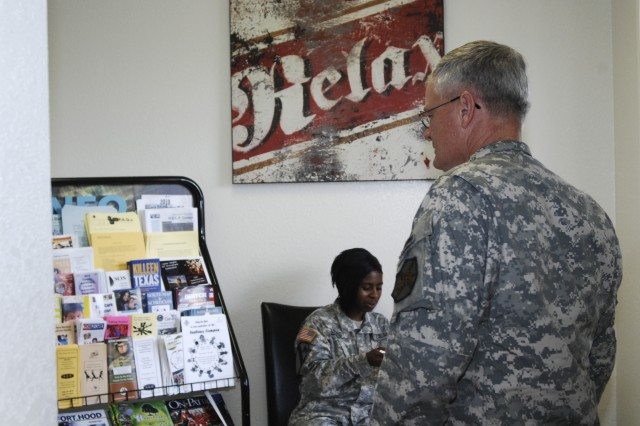 Fort Hood's U.S. Army Garrison senior noncommissioned officer, Command Sgt. Maj. Donald Felt, looks at the Fort Hood information available in the entryway of the newly opened Harker Heights Community Outreach Center Sept. 9.