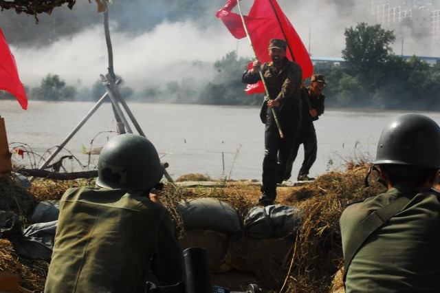 A Republic of Korea army soldier prepares to fire at on-rushing north Korean soldiers, who crossed the Nak-dong River during the re-enactment.