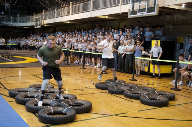Lance Cpl. Joshua Wege and Pvt. Harrison Ruzicka race past a cheering Corps of Cadets crowd as they make their way through the Indoor Obstacle Course Test at West Point, N.Y., on Sept. 10.
