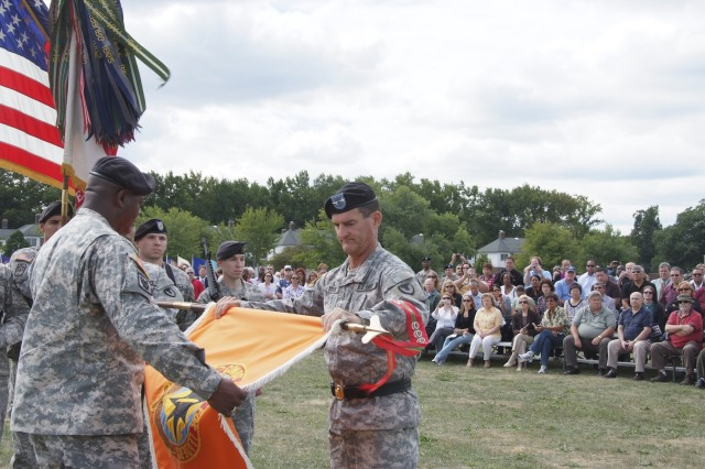 Maj. Gen. Randolph P. Strong (right) and Command Sgt. Maj. Tyrone Johnson begin to furl the CECOM flag before sheathing and casing it for transport to Aberdeen Proving Ground, Md.