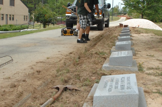 Memorial stones representing each of the Soldiers who died in combat while serving as a member of the 3rd Special Forces Group (A) since its re-activation on July 1, 1990.  Jacob Netzel, a member of Boy Scout Troop 40, led the project by raising $40,000 for the stones and the materials and submitting the requests for approval.  Each stone is 30 inches long, 18 inches wide and 4 inches high. There will be a dedication ceremony for the memorial on or around Dec. 2.