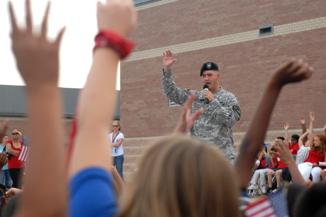KILLEEN, Texas - Maj. Dan Legereit, of Metropolis, Ill., the executive officer for 4th Attack Reconnaissance Battalion, 227th Aviation Regiment, 1st Air Cavalry Brigade, 1st Cavalry Division, asks students at Trimmier Elementary School what freedom means to them. Legereit, along with nearly 40 Soldiers from 4-227th, visited the school to help the children and faculty memorialize the events of 9/11, Sept. 10.