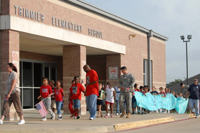 KILLEEN, Texas -  After a morning of presentations and activities, the students of Trimmier Elementary School and Soldiers from 4th Attack Reconnaissance Battalion, 227th Aviation Regiment, 1st Air Cavalry Brigade, 1st Cavalry Division, walk around the school during the annual Freedom Walk, Sept. 10.