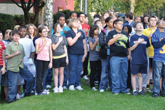 Students, teachers and parents recite the Pledge of Allegiance during the Wiesbaden Middle School's Patriot/Constitution Day observance.