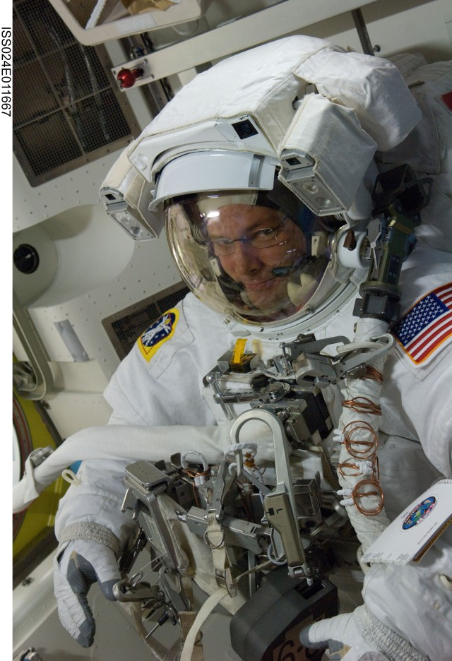 NASA astronaut Doug Wheelock, Expedition 24 flight engineer, attired in his Extravehicular Mobility Unit (EMU) spacesuit, is pictured in the Quest airlock of the International Space Station during preparations for the second of three planned spacewal...