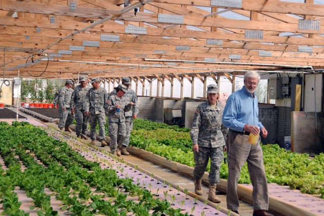 Jim Moseley, a farmer and former deputy secretary of the U.S. Department of Agriculture, takes Soldiers and Airmen from the 3-19th Indiana Agribusiness Development Team on a tour of his hydroponics farm Sept. 3 as part of their mobilization training.