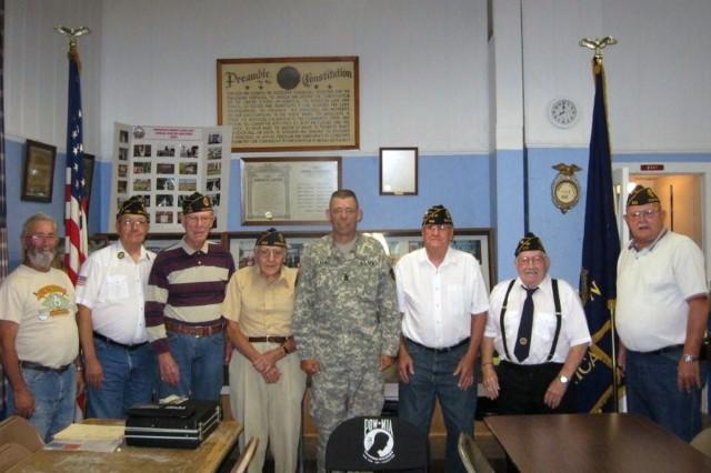 Command Sgt. Maj. Stephen D. Blake with members of American Legion Post 532, Donahue, Iowa.