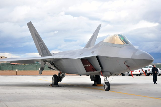 HILL AIR FORCE BASE, Utah -- An Air Force F-22 Raptor sits in front of the new Fuel Composite Overhaul Test Facility at Hill Air Force Base, Utah, Sept. 9. Built by the U.S. Army Corps of Engineers Sacramento District,, the $39.2 million, 75,000 square-feet facility will serve as a painting and maintenance facility for the Raptor.