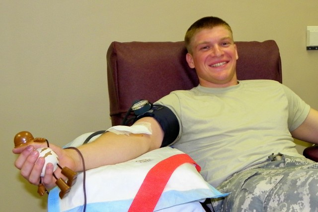 BUFFALO, NY--New York Army National Guard Specialist Brinindune Taylor, a medic with Headquarters and Headquarters Troop, 2nd Squadron, 101 Cavalry, makes his donation during a combined 9/11 Commemorative March and Blood Drive.