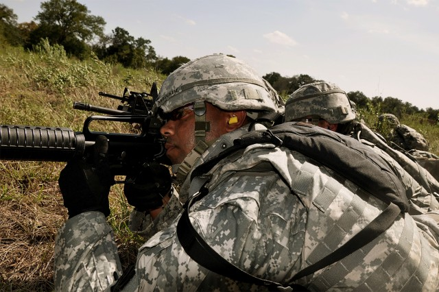 FORT HOOD, Texas-Spc. Jamel Abdulaziz, a Cleveland native and radio operator specialist with Battery A, 26th Field Artillery Regiment, 41st Fires Brigade, places his team in a 360 degree perimeter during a cordon and search training mission on North Fort Hood, Texas, Sept. 10.