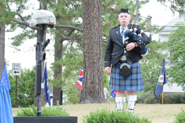 Bagpiper Edward Wilkes plays Amazing Grace at the end of Fort Jackson's ceremony commemorating the vicitms of 9/11 and the fallen in the war on terrorism.