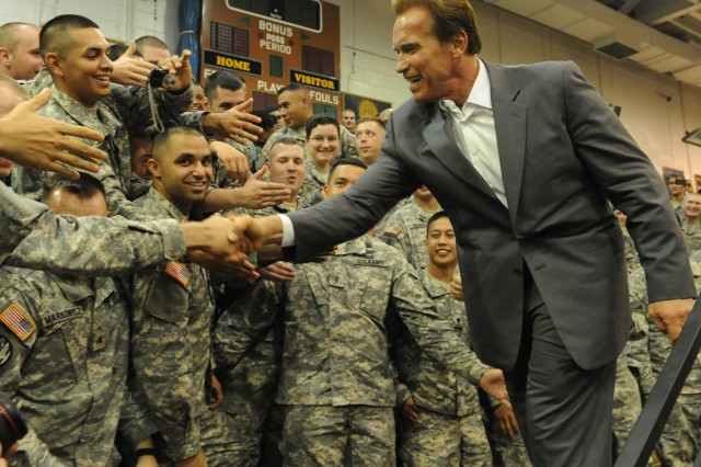 California Gov. Arnold Schwarzenegger shakes hands with U.S. troops during a rally on Yongsan Garrison Sept. 15.