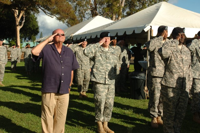 "Former CSA and CG current AUSA President, Army Gen. retired Gordon R. Sullivan visits and Maj. Gen. Bernard Champoux, Commanding General, 25th Inf. Div., render salutes to the U.S. flag as it is lowered during ""Retreat"" at Schofield Barracks, Hawaii, Sept. 14. Sullivan visited Schofield Barracks to meet with Tropic Lightning Leadership and tour the island. (U.S. Army photo by Lt. Col. Sean Wilson, 25th Infantry Division Public Affairs)"